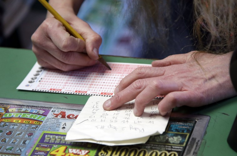 Numbers are placed on a Powerball form at Kavanagh Liquors Wednesday, Jan. 13, 2016, in San Lorenzo, Calif. The Powerball jackpot for Wednesday night's drawing is at least $1.5 billion, the largest lottery jackpot in the world. (AP Photo/Marcio Jose Sanchez)