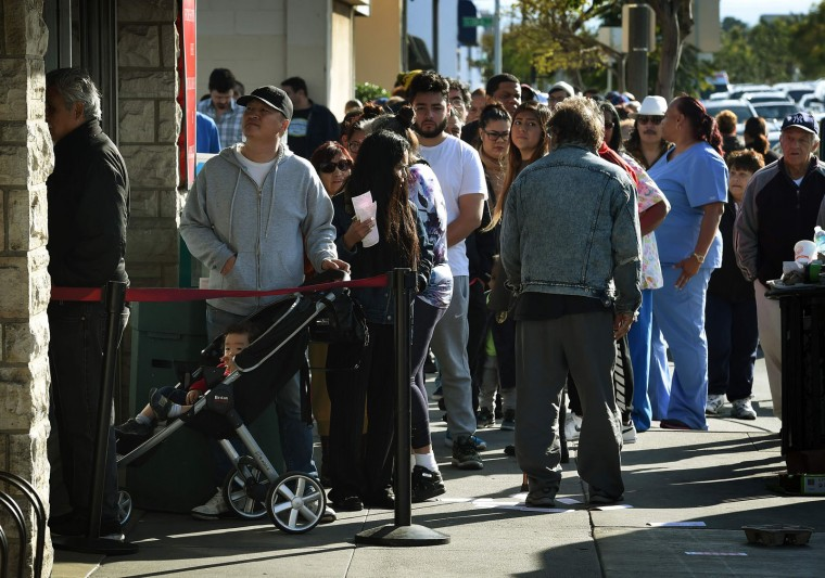 People line up to buy California Powerball lottery tickets at the famous Bluebird Liquor store, considered to be a lucky retailer of tickets, in Hawthorne, California on January 13, 2016. Record sales drove up the largest jackpot in US history to a whopping $1.5 billion as people dreaming of riches flocked across state lines and international borders to buy tickets. (Mark Ralston/AFP/Getty Images)