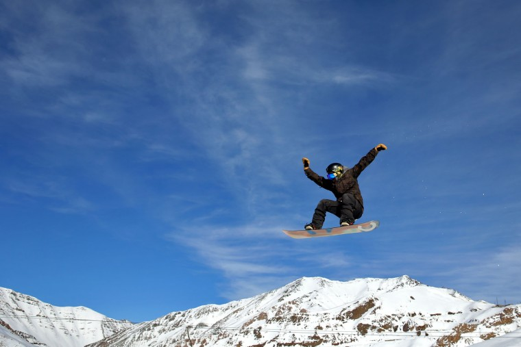 In this Friday, Jan. 15, 2016 photo, an Iranian snowboarder trains at Dizin Ski Resort some 72 kilometers (45 miles) north of the capital Tehran, Iran. Every weekend, Dizin ski resort in the Alborz mountain range, north of Tehran, draws hundreds of skiers from the capital and other towns. (AP Photo/Ebrahim Noroozi)