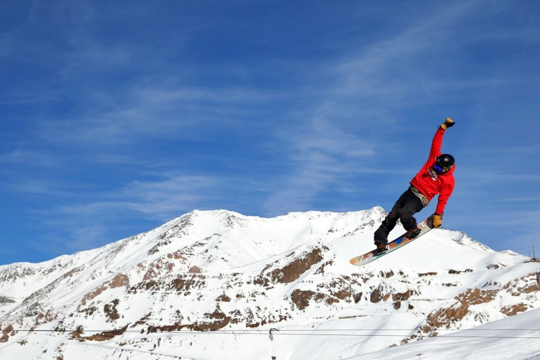 In this Friday, Jan. 15, 2016 photo, an Iranian snowboarder trains at Dizin Ski Resort some 72 kilometers (45 miles) north of the capital Tehran, Iran. Every weekend, the resort in the Alborz mountain range, north of Tehran, draws hundreds of skiers from the capital and other towns. (AP Photo/Ebrahim Noroozi)