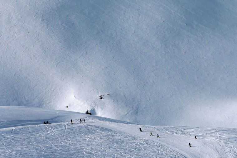 In this Friday, Jan. 15, 2016 photo, Iranian skiers descend from a slope at at Dizin Ski Resort some 72 kilometers (45 miles) north of the capital Tehran, Iran. Every weekend, the resort in the Alborz mountain range, north of Tehran, draws hundreds of skiers from the capital and other towns. (AP Photo/Ebrahim Noroozi)
