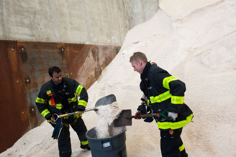 New York Fire Department firefighters stock up on salt before New York City Mayor Bill De Blasio speaks about the city's preparedness for an upcoming snowstorm at the Spring Street salt shed on January 21, 2016 in New York, NY. Winter Storm Jonas is expected to hit New York City between Friday afternoon and Saturday morning and the National Weather Service recently included New York City on a blizzard watch. (Bryan Thomas/Getty Images)