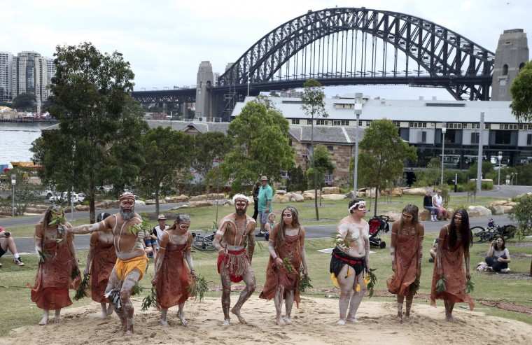 Traditional Aboriginal dancers perform on Australia Day in Sydney, Australia, Tuesday, Jan. 26, 2016. Australia Day is the anniversary of the arrival and landing of the First Fleet of convict ships from Great Britain, and the raising of the Union Jack at Sydney Cove by Captain Arthur Phillip, on Jan 26, 1788. (AP Photo/Rob Griffith)