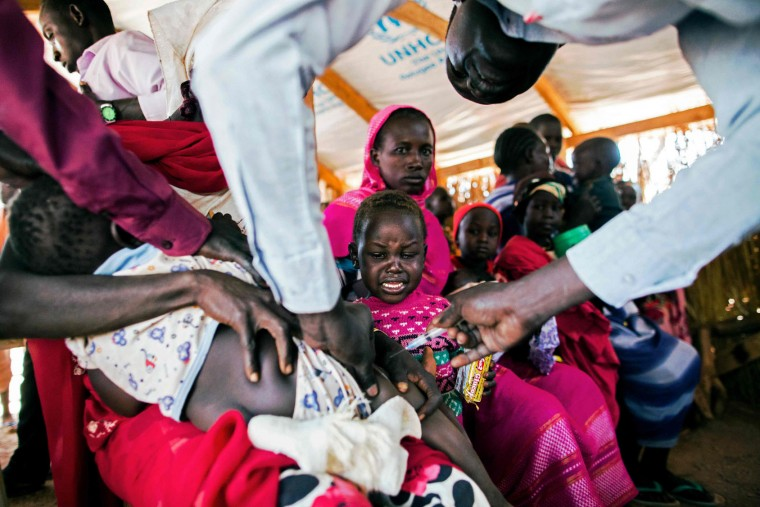 "Asylum seekers from Sudan, who recently arrived into South Sudan, receive medical assistance at the refugee camp in Ajuong Thok, near Yida, northern South Sudan, on January 26, 2016. Both South Sudan's Rebel leader Riek Machar and South Sudan's President Salva Kiir signed a peace deal in August but have consistently broken ceasefires. The opposing sides missed a January 22, 2016 deadline to form a unity government amid a dispute over Kiirs reorganization of the oil-producing country into 28 states. United Nations (UN) sanctions monitors have stated in a confidential report that The U.N Security Council should place an arms embargo on South Sudan, and that both President Kiir and Riek Machar ""qualify"" for sanctions over atrocities committed during the two year civil war in the country. The civil war in South Sudan has left tens of thousands of people dead and forced more than 2 million others to flee their homes since erupting in December 2013. (Albert Gonzalez Farran/AFP/Getty Images)"