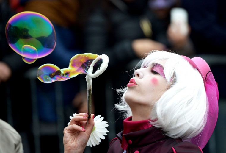 "A costumed reveller blows bubbles while waiting for the performance of the ""Angel flight"" or ""Flight of the dove"" from the bell tower of Saint Mark's square (Piazza San Marco) to officially launch the Venice Carnival on January 31, 2016. The 2016 edition of the Venice carnival has for theme ""Creatum"" and runs until February 9. (Vincenzo Pinto/AFP/Getty Images)"