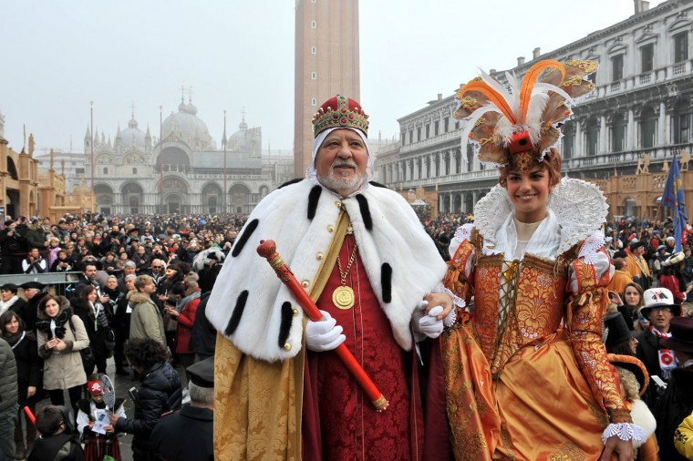 "Irene Rizzi, right, poses with a man impersonating the Doge of Venice after descending from the bell tower into St. Mark's Square, in Venice, Sunday, Jan. 31, 2016. Carnival-goers in Venice are being asked by police to momentarily lift their masks as part of new anti-terrorism measures for the annual festivities. Sunday's main crowd-pleaser known as the Flight of the Angel went off without a hitch. In that event, a costumed young woman, attached by wires, "" flies "" over the crowd, starting from St. Mark's bell tower and gradually descending to the square. (AP Photo/Luigi Costantini)"