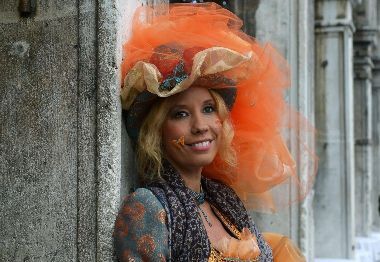"Costumed reveller poses in St Mark's square (Piazza San Marco) after the officially launch of the Venice Carnival on January 31, 2016 in Venice. The 2016 edition of the Venice carnival is untitled ""Creatum"" and runs until February 9th. (Vincenzo Pinto/AFP/Getty Images)"