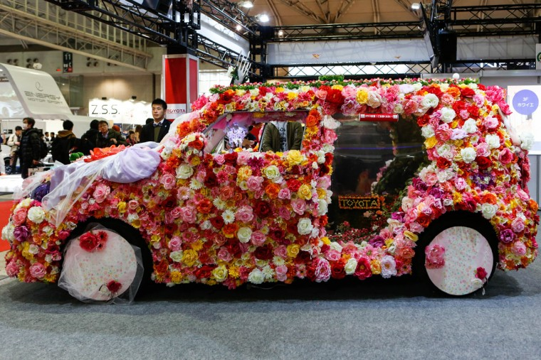 A custom car heavily decorated in flowers is shown on display at the 2016 Tokyo Auto Salon car show on January 15, 2016 in Chiba, Japan. (Photo by Christopher Jue/Getty Images)
