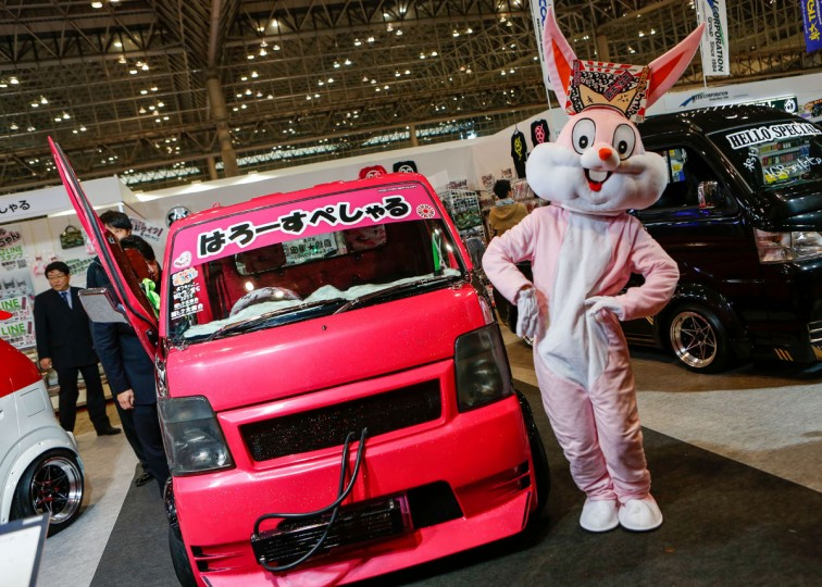 A rabbit character stands next to a custom car on display at the 2016 Tokyo Auto Salon car show on January 15, 2016 in Chiba, Japan. (Photo by Christopher Jue/Getty Images)