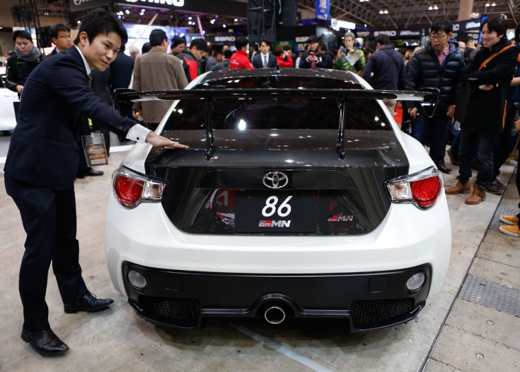 An exhibitor touches the carbon fiber trunk of a Toyota GRMN 86 vehicle on display during the 2016 Tokyo Auto Salon car show on January 15, 2016 in Chiba, Japan. TOKYO AUTO SALON 2016 is held from January 15 to 17, 2016. (Photo by Christopher Jue/Getty Images)