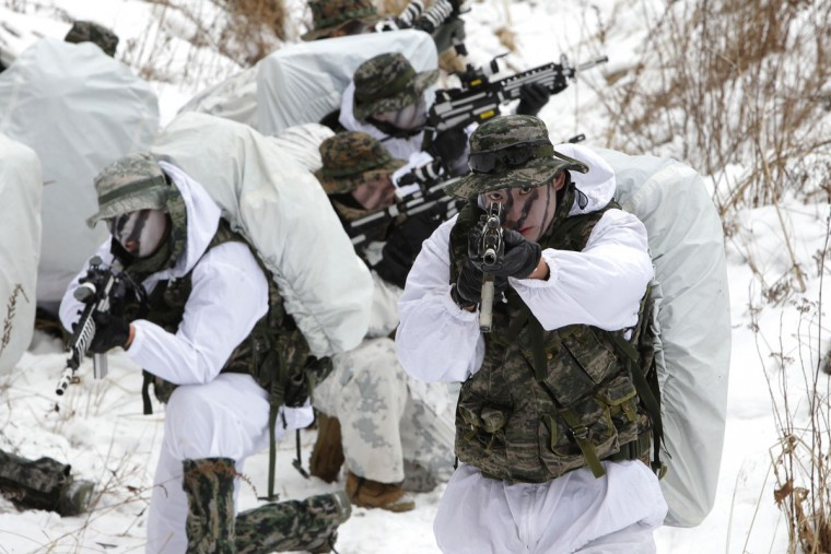 U.S. Marines from 3rd Marine Expeditionary force deployed from Okinawa, Japan, participate in the winter military training exercise with South Korean soldiers on January 28, 2016 in Pyeongchang-gun, South Korea. U.S. and South Korean marines participate in the endurance exercise in temperature below minus 20 degrees celsius under a scenario to defend the country from any possible attacks from North Korea. (Photo by Chung Sung-Jun/Getty Images)