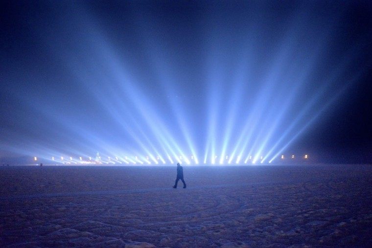 A man walks on the frozen Songhua river beside the Harbin international ice and snow festival in Harbin, northeast China's Heilongjiang province on January 3, 2016. (WANG ZHAO/AFP/Getty Images)