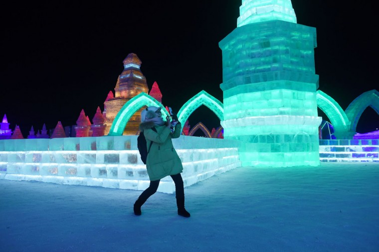 A woman uses a mobile phone to take a picture at the China Ice and Snow World on the eve of the opening ceremony of the Harbin International Ice and Snow Festival in Harbin, northeast China's Heilongjiang province on January 4, 2016. (WANG ZHAO/AFP/Getty Images)