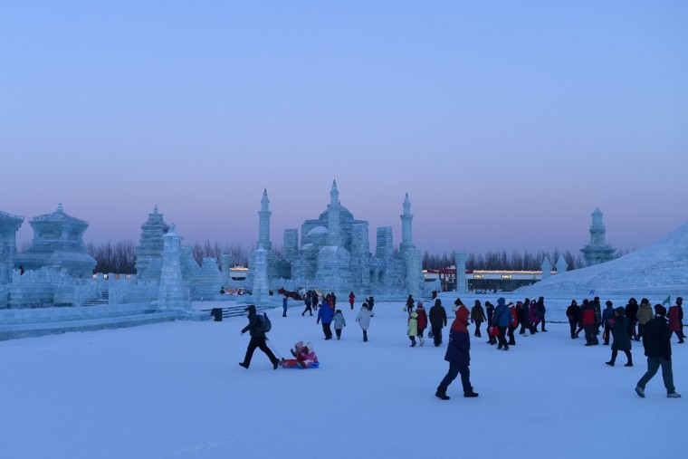 People visit the China Ice and Snow World on the eve of the opening ceremony of the Harbin International Ice and Snow Festival in Harbin, northeast China's Heilongjiang province on January 4, 2016. (WANG ZHAO/AFP/Getty Images)