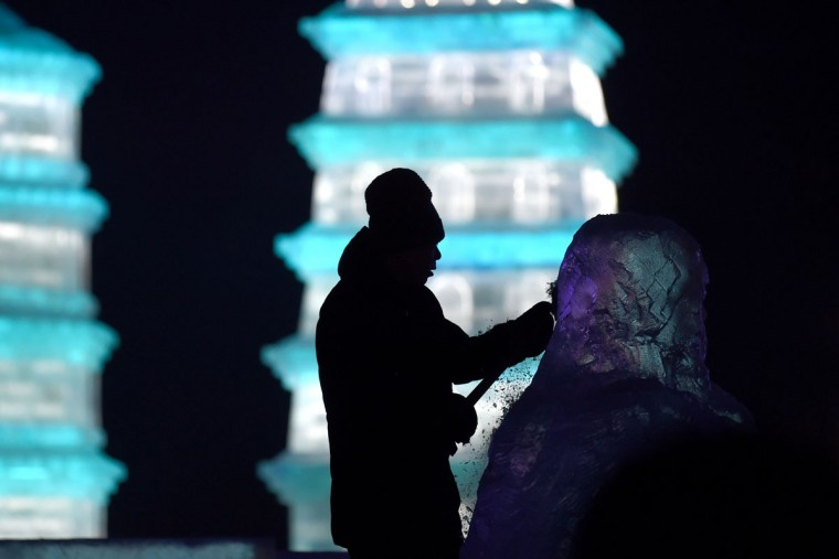 A worker carves an ice sculpture at the China Ice and Snow World on eve of the opening ceremony of the Harbin International Ice and Snow Festival in Harbin, northeast China's Heilongjiang province on January 4, 2016. (WANG ZHAO/AFP/Getty Images)