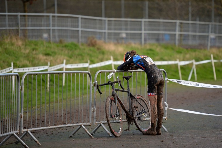 Helen Wyman rests after crossing the finish line in second place after the Elite Women's Championship of the 2016 British Cycling National Cyclo-Cross Championships at Shrewsbury Sports Village on January 10, 2016 in Shrewsbury, Central England. (OLI SCARFF/AFP/Getty Images)