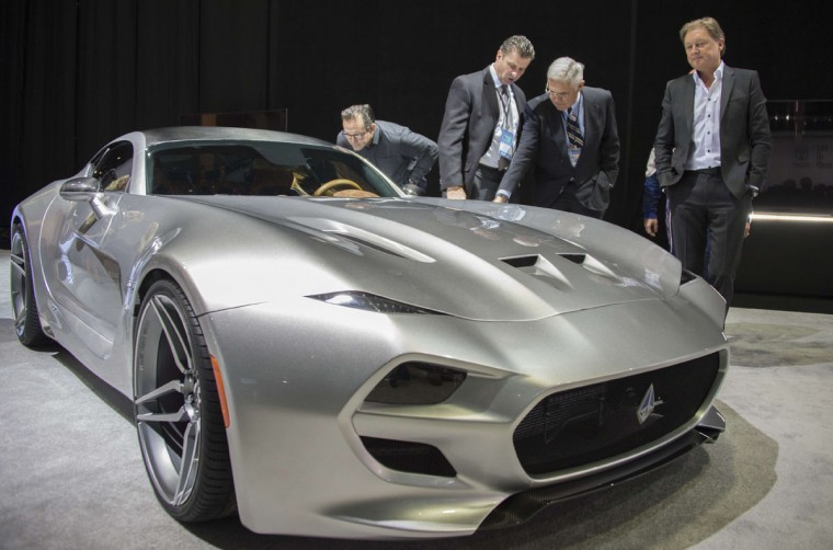 Gilbert Villarreal (2nd L), Bob Lutz (2nd R), and Fisker co-founder and namesake Henrik Fisker (R) unveil the VLF Coupe during the VLF press conference at the North American International Auto Show in Detroit, Michigan, January 12, 2016. (JIM WATSON/AFP/Getty Images)
