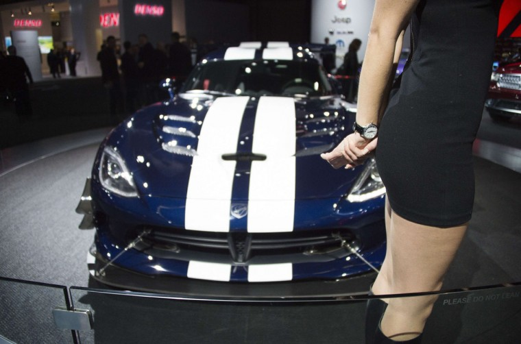A model stands in front of the Dodge Viper at the North American International Auto Show in Detroit, Michigan, January 12, 2016. (JIM WATSON/AFP/Getty Images)