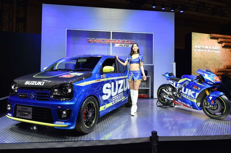 Suzuki Motor displays the Alto Works GP (L) wearing a MotoGP color at Tokyo Auto Salon 2016 at Makuhari Messe in Chiba on January 15, 2016. The exhibition, which is one of the largest annual custom car and car-related product shows, is being held from January 15 to January 17. (AFP Photo/Kazuhiro Nogi)