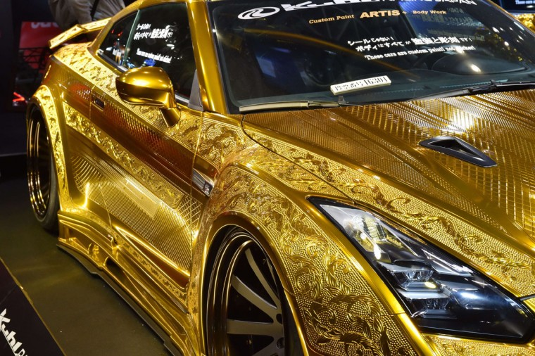 Japan's Kuhl racing and arts displays a custom car Project R35GT-R, painted with gold metal paint and 3D diamond block on the Nissan GT-R, at Tokyo Auto Salon 2016 at Makuhari Messe in Chiba on January 15, 2016. The exhibition, which is one of the largest annual custom car and car-related product shows, is being held from January 15 to January 17. (AFP Photo/Kazuhiro Nogi)