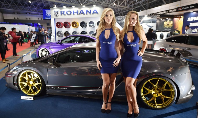 Models pose for photographers at Tokyo Auto Salon 2016 at Makuhari Messe in Chiba on January 15, 2016. The exhibition, one of the largest annual custom car and car-related product show, held here over the three-day period from January 15 to January 17. (AFP Photo/Kazuhiro Nogi)