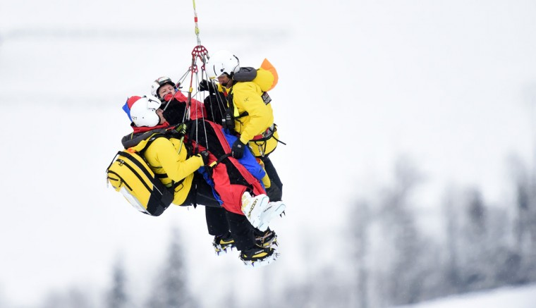 Hannes Reichelt from Austria is transported by medical helicopter staff after crashing during the Audi FIS Alpine Ski World Cup Men's Downhill on January 23, 2016 in Kitzbuehel, Austria. (CHRISTOF STACHE/AFP/Getty Images)
