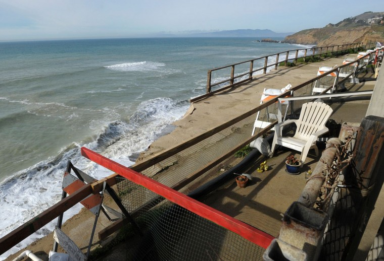 A broken off section of land is cordoned off at an apartment complex where an eroding cliff has residents evacuating in Pacifica, California on January 26, 2016. Storms and powerful waves caused by El Nino have been intensifying erosion along nearby coastal bluffs and beaches in the area.(JOSH EDELSON/AFP/Getty Images)