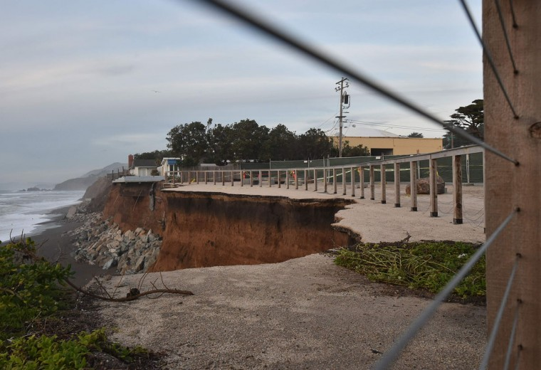 Sections of land are seen missing after falling to the sea in Pacifica, California on January 26, 2016, as storms and powerful waves caused by El Nino have been intensifying erosion along nearby coastal bluffs and beaches in the area. (JOSH EDELSON/AFP/Getty Images)