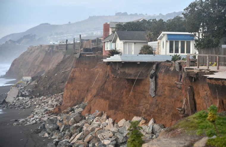 Sections of land are seen missing from coastal properties in Pacifica, California on January 26, 2016. Storms and powerful waves caused by El Nino have been intensifying erosion along nearby coastal bluffs and beaches in the area. (JOSH EDELSON/AFP/Getty Images)
