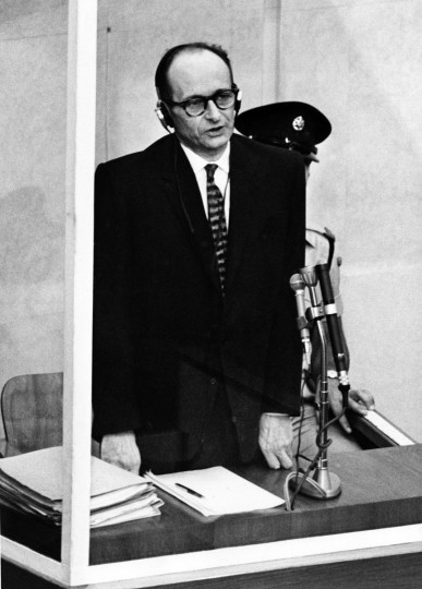 This file photo taken on April 11, 1961 shows Nazi war criminal Adolf Eichmann standing in his bullet-proof dock during the first day of his trial in front of an Israeli court, 11 April 1961, in Jerusalem. Israeli President Reuven Rivlin is to make public previously unreleased documents including a handwritten request for clemency from Nazi war criminal Adolf Eichmann, on International Holocaust Remembrance Day on January 27, 2016. Former Nazi SS leader, and one of the main organizers of the extermination camps in Nazi-occupied Eastern Europe, was captured by Israeli Mossad agents in Argentina, indicted by Israeli court on 15 criminal charges, including charges of crimes against humanity, crimes against the Jewish people and membership of an outlawed organization. He was sentenced to death 15 December 1961 and executed in 1962 in Jerusalem. (AFP Photo)