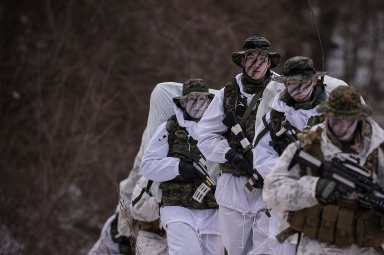 South Korean and US soldiers walk in the snow during a joint annual winter exercise in Pyeongchang, some 180 kilometers east of Seoul, on January 28, 2016. The Korean peninsula is the world's last Cold War frontier as Stalinist North Korea and pro-Western South Korea have been technically at war since the 1950-53 conflict. (ED JONES/AFP/Getty Images)