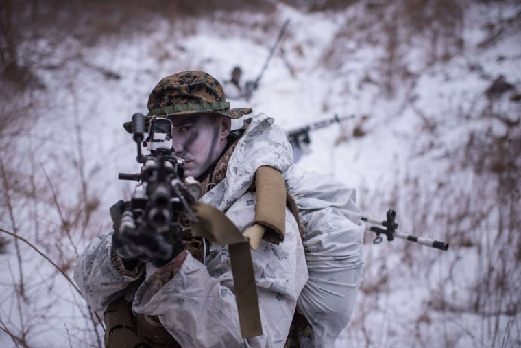 A US soldier poses for photographers during a joint annual winter exercise in Pyeongchang, some 180 kilometers east of Seoul, on January 28, 2016. The Korean peninsula is the world's last Cold War frontier as Stalinist North Korea and pro-Western South Korea have been technically at war since the 1950-53 conflict. (ED JONES/AFP/Getty)