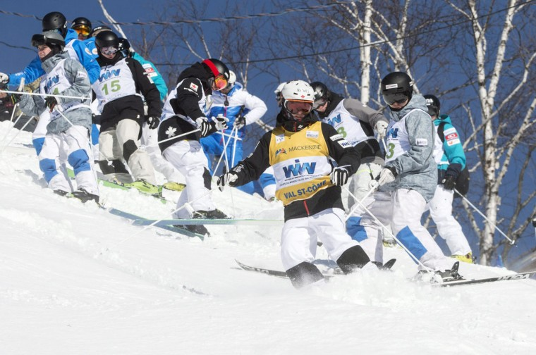 Canada's Mikael Kingsbury leads other skiers in grooming the course prior to moguls competition at the FIS Freestyle Ski World Cup on Saturday, Jan. 23, 2016, in Val Saint-Come, Canada. (Paul Chiasson/The Canadian Press via AP)