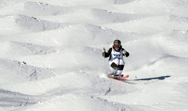 Canada's Justine Dufour-Lapointe competes in the final to go on to win the in the women's moguls competition at the FIS Freestyle Ski World Cup on Saturday, Jan. 23, 2016, in Val Saint-Come, Canada. (Paul Chiasson/The Canadian Press via AP)