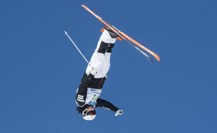 Canada's Laurent Dumais performs a jump in the qualifying round to go on to win this place in the men's moguls at the FIS Freestyle Ski World Cup on Saturday, Jan. 23, 2016, in Val Saint-Come, Canada. (Paul Chiasson/The Canadian Press via AP)