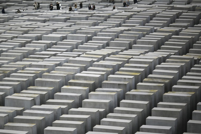 A group of visitors walk inside the Holocaust Memorial at the International Holocaust Remembrance Day in Berlin, Wednesday, Jan. 27, 2016. The International Holocaust Remembrance Day marks the liberation of the Auschwitz Nazi death camp on Jan. 27, 1945. (AP Photo/Markus Schreiber)