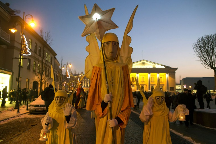 People parade through the streets as part of celebrations of Three Kings Day in downtown Vilnius, Lithuania, Wednesday, Jan. 6, 2016. Epiphany, the 12th night of Christmas, marks the day the three wise men visited Christ. (AP Photo/Mindaugas Kulbis)