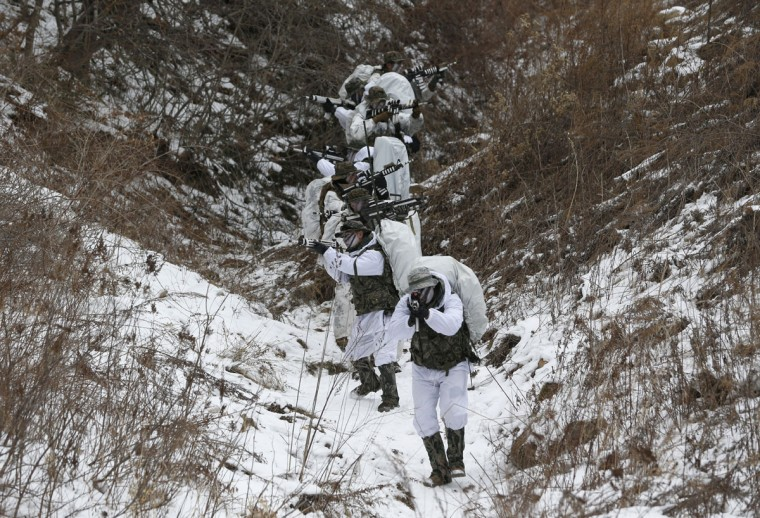 South Korean marines and U.S. Marines from 3rd Division Expeditionary Forces demonstrate in their reconnaissance mission during a combined military winter exercise in Pyeongchang, South Korea, Thursday, Jan. 28, 2016. About 200 marines from the two countries participated the three-week winter combined exercise in South Korea. (AP Photo/Lee Jin-man)