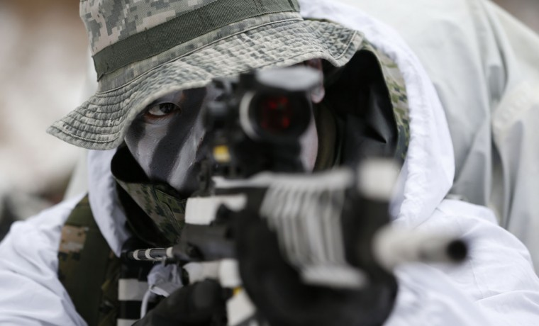 A South Korean marine aims his gun during a combined military winter exercise with U.S. Marines from 3rd Division Expeditionary Forces in Pyeongchang, South Korea, Thursday, Jan. 28, 2016. About 200 marines from the two countries participated the three-week winter combined exercise in South Korea. (AP Photo/Lee Jin-man)