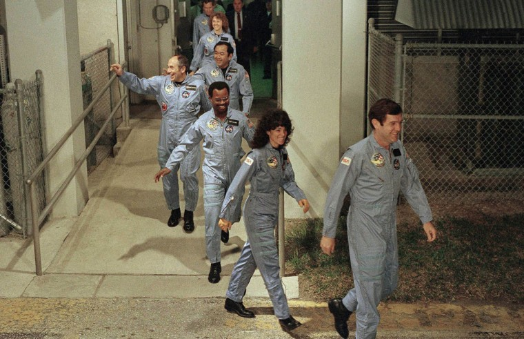 In this Jan. 27, 1986 file picture, the crew members of space shuttle Challenger flight 51-L, leave their quarters for the launch pad at Kennedy Space Center in Cape Canaveral, Fla. From foreground are commander Francis Scobee, Mission Spl. Judith Resnik, Mission Spl. Ronald McNair, Payload Spl. Gregory Jarvis, Mission Spl. Ellison Onizuka, teacher Christa McAuliffe and pilot Michael Smith. (AP Photo/Steve Helber)
