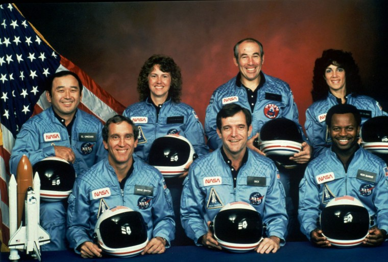 This photo provided by NASA shows the crew of the Space Shuttle Challenger mission 51L. All seven members of the crew were killed when the shuttle exploded during launch on Jan. 28, 1986. Front row from left are Michael J. Smith, Francis R. (Dick) Scobee, and Ronald E. McNair. Front row from left are Ellison Onizuka, Christa McAuliffe, Gregory Jarvis, and Judith Resnik. (NASA via AP)