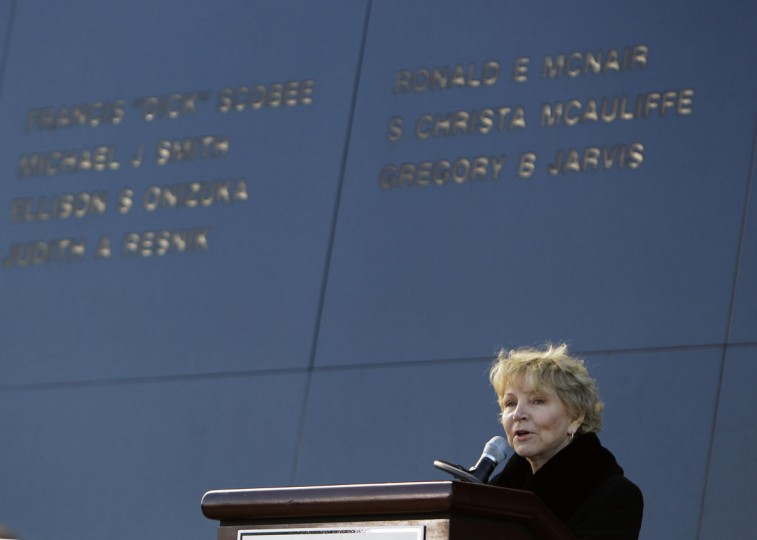 In this Friday, Jan. 28, 2011 file photo, June Scobee Rodgers, widow of Dick Scobee, commander of space shuttle Challenger, speaks in front of the Space Mirror Memorial during a remembrance ceremony to mark the 25th Anniversary of space shuttle Challenger at the Kennedy Space Center visitor complex in Cape Canaveral, Fla. On the memorial behind her are the names of the astronauts that perished aboard Challenger. (AP Photo/John Raoux)