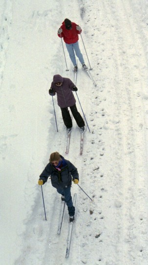 Skiing down Light St. next to the Light St. Pavilion are front to back: Priscilla Henderer, Helen Holden and Susan Holden, all from Federal Hill. (Algerina Perna/Baltimore Sun)