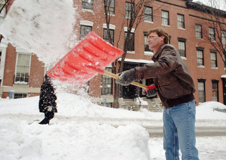Michael Gosselin shovels out a space for himself at work. He works for Enhansco. (Hillery Smith/Baltimore Sun)
