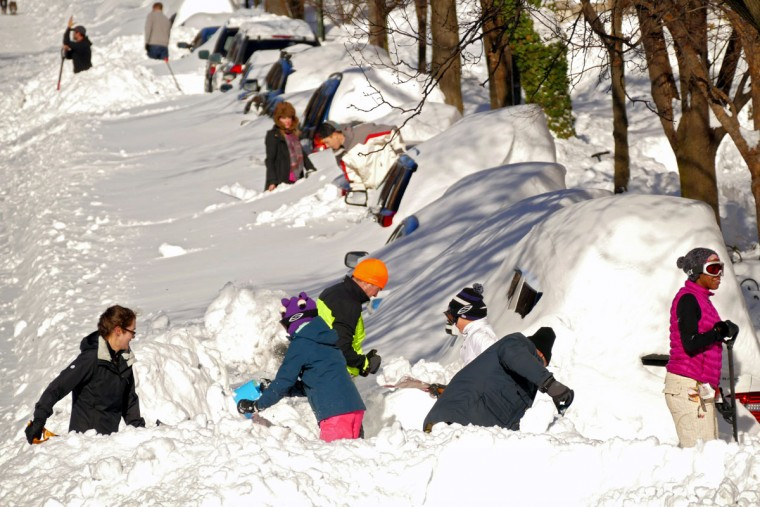 Residents dig out Sunday in Bolton Hill. It could take days to clear away snow, officials warned, with plows and snowblowers not expected to start getting ahead of the more than 2 feet of drifting snow until Sunday. (Karl Merton Ferron / Baltimore Sun)