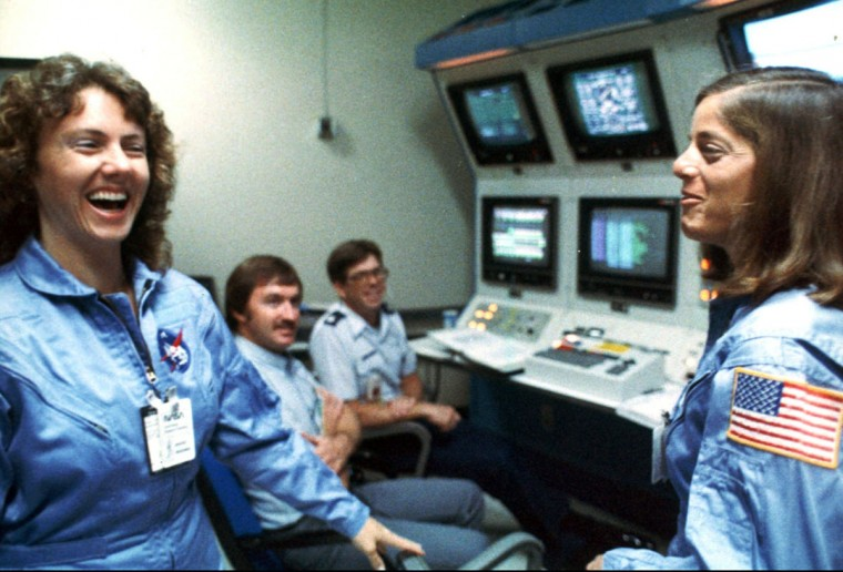Christa McAuliffe, left, and Barbara Morgan, right, laugh with each other during training in in the months before the Challenger mission. Sixteen years after Christa McAuliffe and six other astronauts died in the Challenger explosion, NASA announced Friday, April 12, 2002, that McAuliffe's fellow teacher and one-time understudy Barbara Morgan will ride aboard a shuttle in 2004.(AP Photo/NASA)