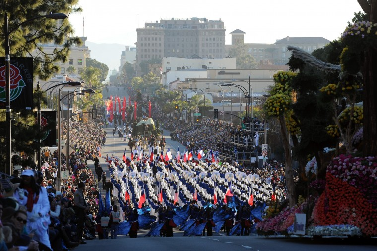Marching bands and floats make their way down Colorado Boulevard at the start of the 127th Rose Parade in Pasadena, Calif., Friday, Jan. 1, 2016. (AP Photo/Michael Owen Baker)