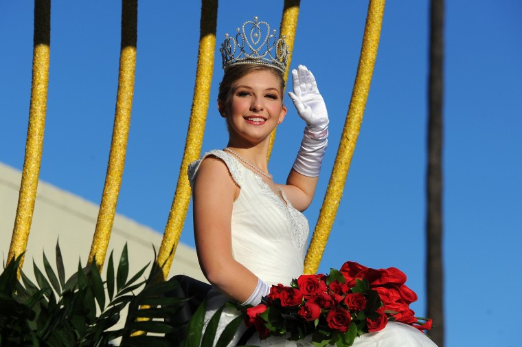Rose Queen Erika Winter rides on a float in the 127th Rose Parade in Pasadena, Calif., Friday, Jan. 1, 2016. (AP Photo/Michael Owen Baker)
