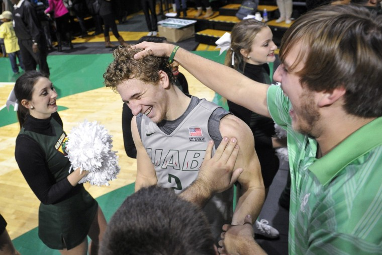 UAB guard Nick Norton (2) is congratulated by fans as he comes off the court after playing against UTEP in an NCAA college basketball game, Saturday, Jan. 9, 2016, in Birmingham, Ala. UAB won 87-80. (John Amis/Associated Press)