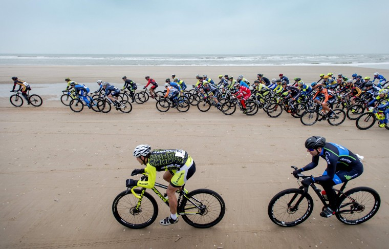 Cyclists ride on the North Sea beach during the Egmond-Pier-Egmond race in Egmond aan Zee, on January 9, 2016. (ROBIN VAN LONKHUIJSEN/AFP/Getty Images)